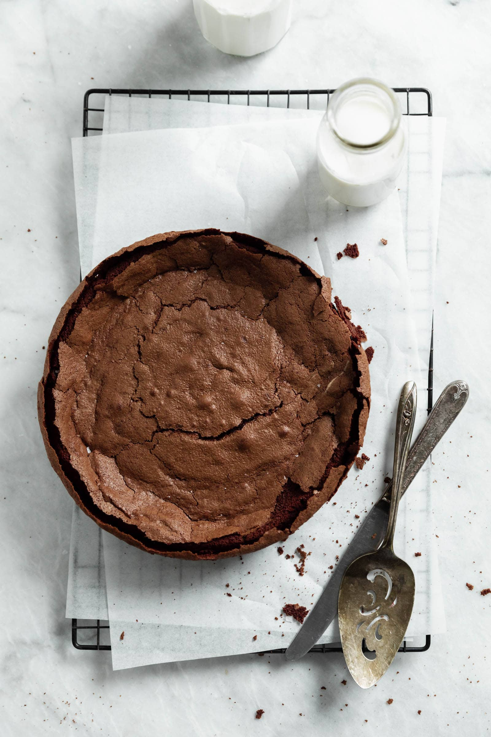 fallen chocolate cake on cooling rack