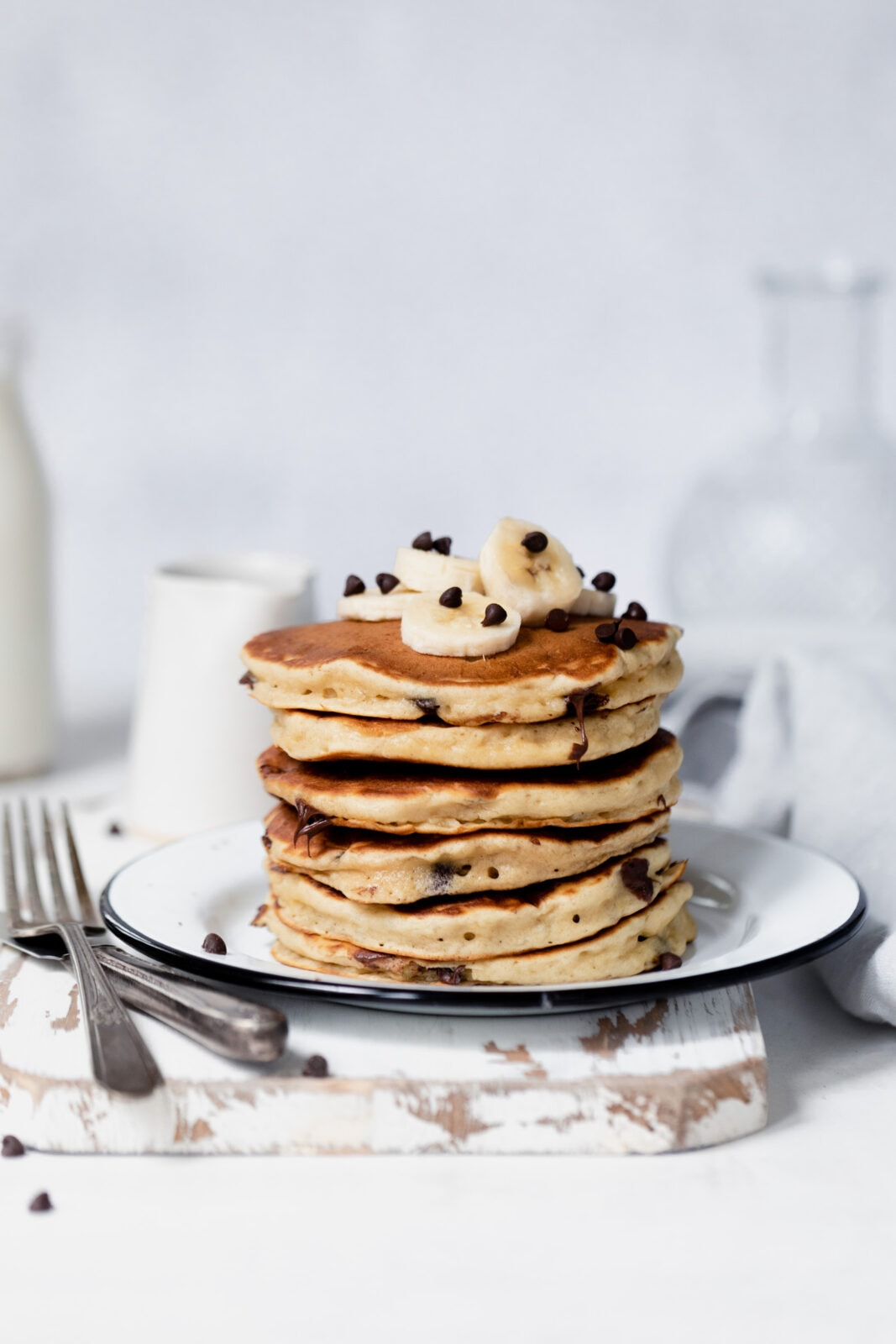 stack of fluffy banana pancakes with chocolate chips