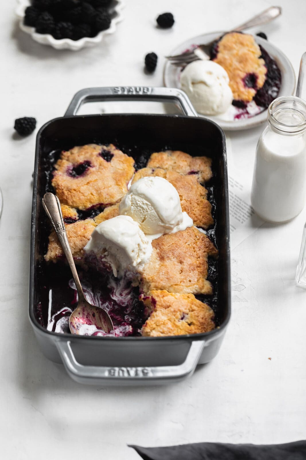 mixed berry cobbler with a spoon