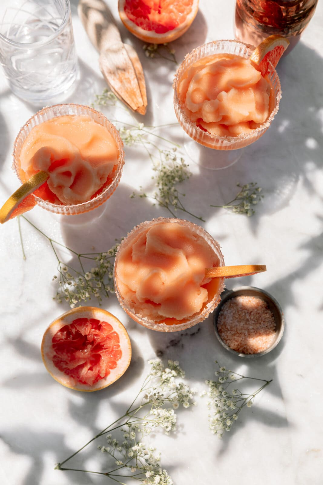 frozen palomas in glasses on a marble counter