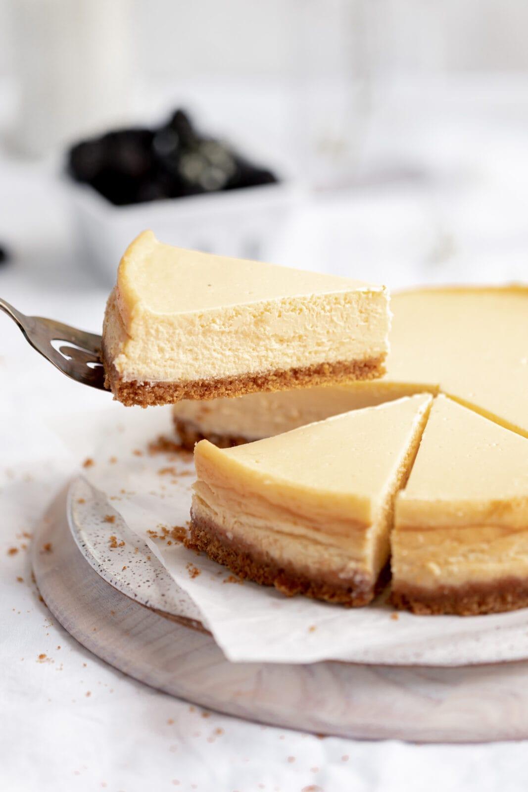 slice of homemade cheesecake with graham cracker crust