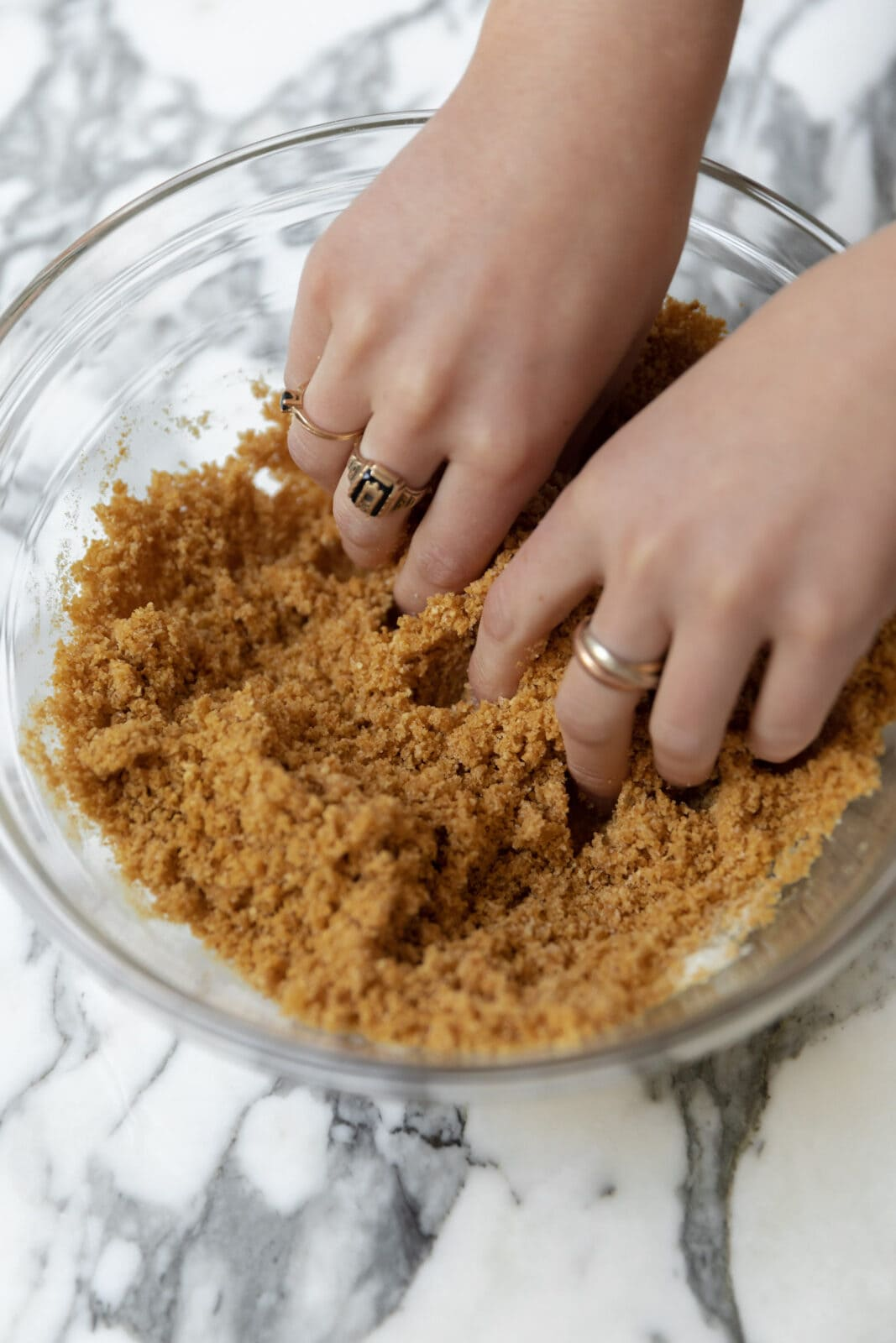rub together the cheesecake batter until it looks like wet sand