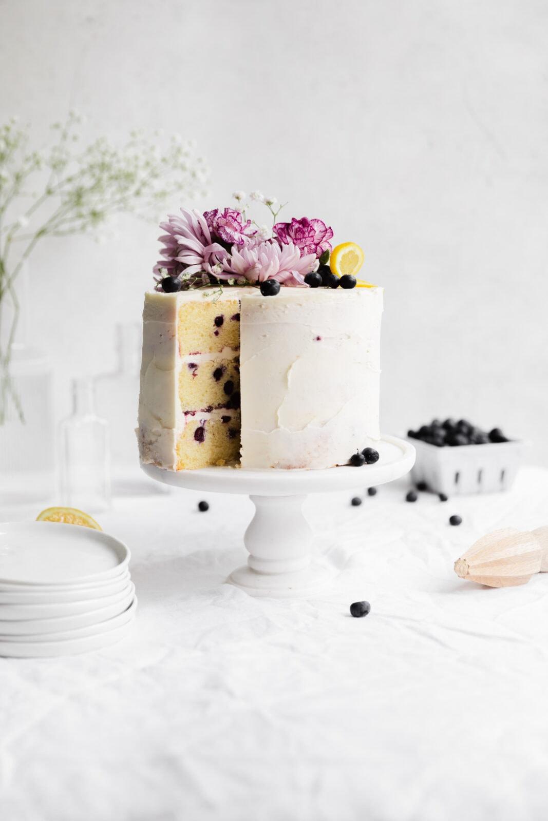lemon blueberry cake on a cake stand