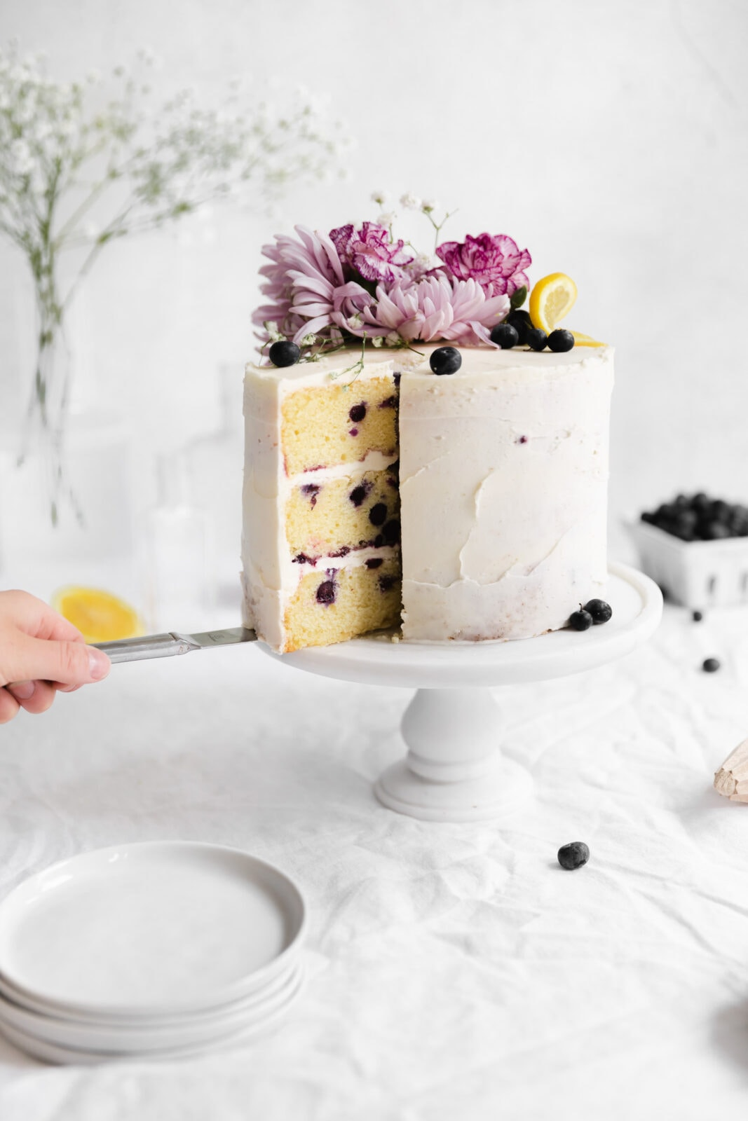 lemon blueberry layer cake with flowers