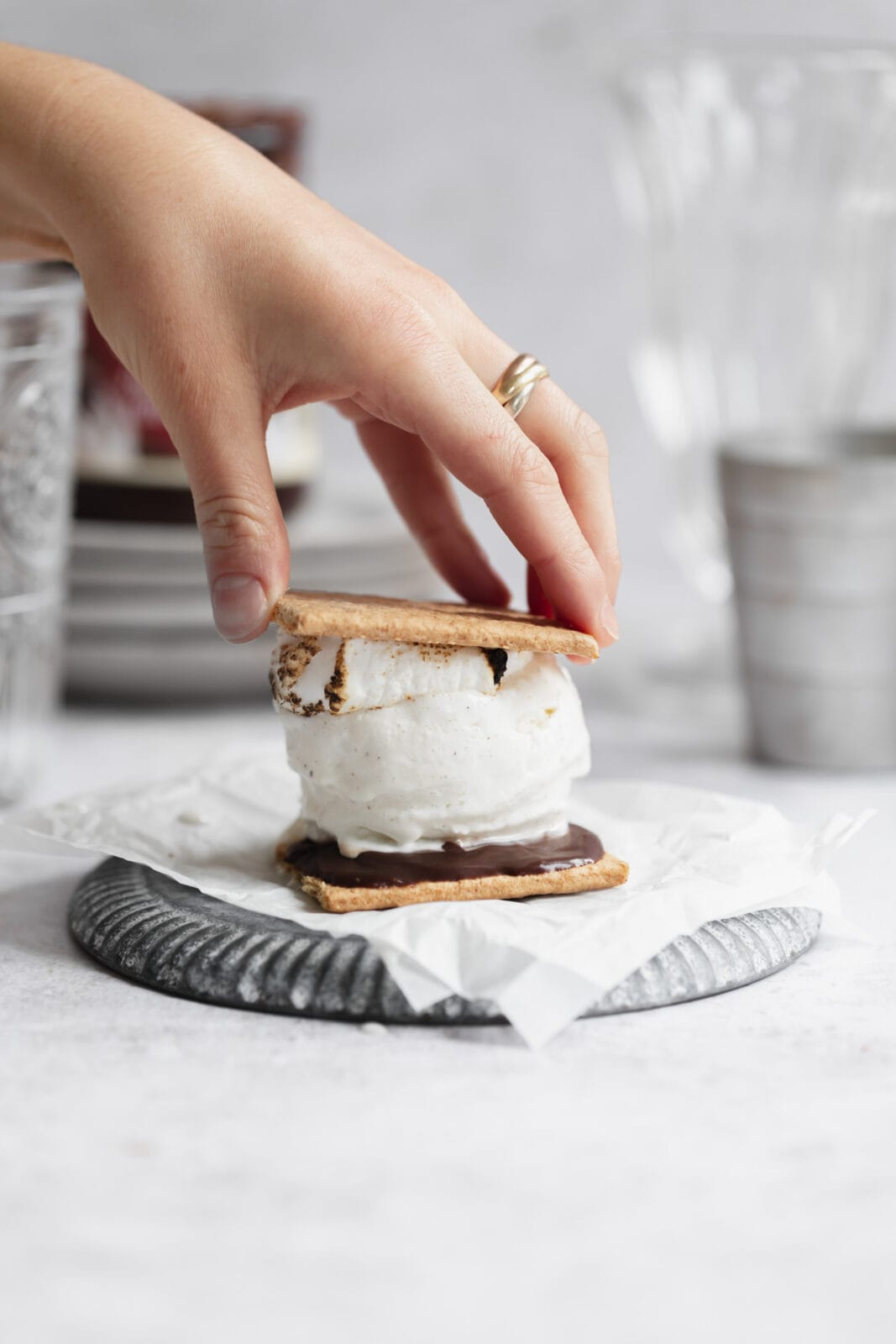 ice cream sandwich with marshmallow, chocolate and graham crackers