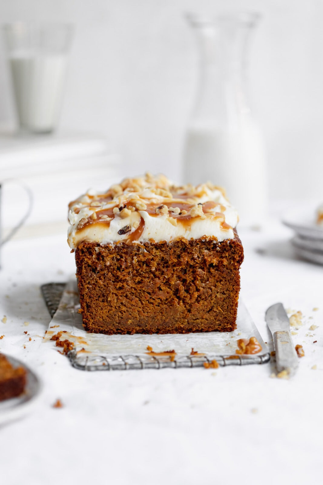 whole wheat carrot cake loaf with cream cheese frosting, caramel and walnuts