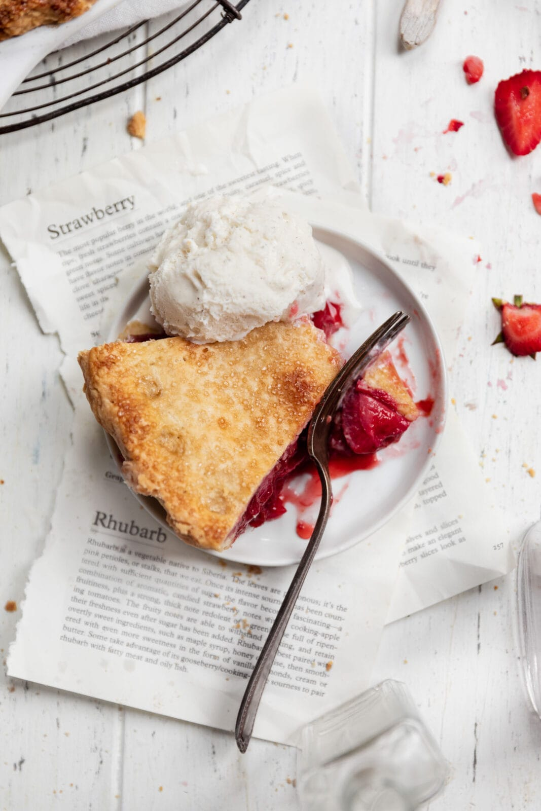 slice of strawberry rhubarb pie with ice cream