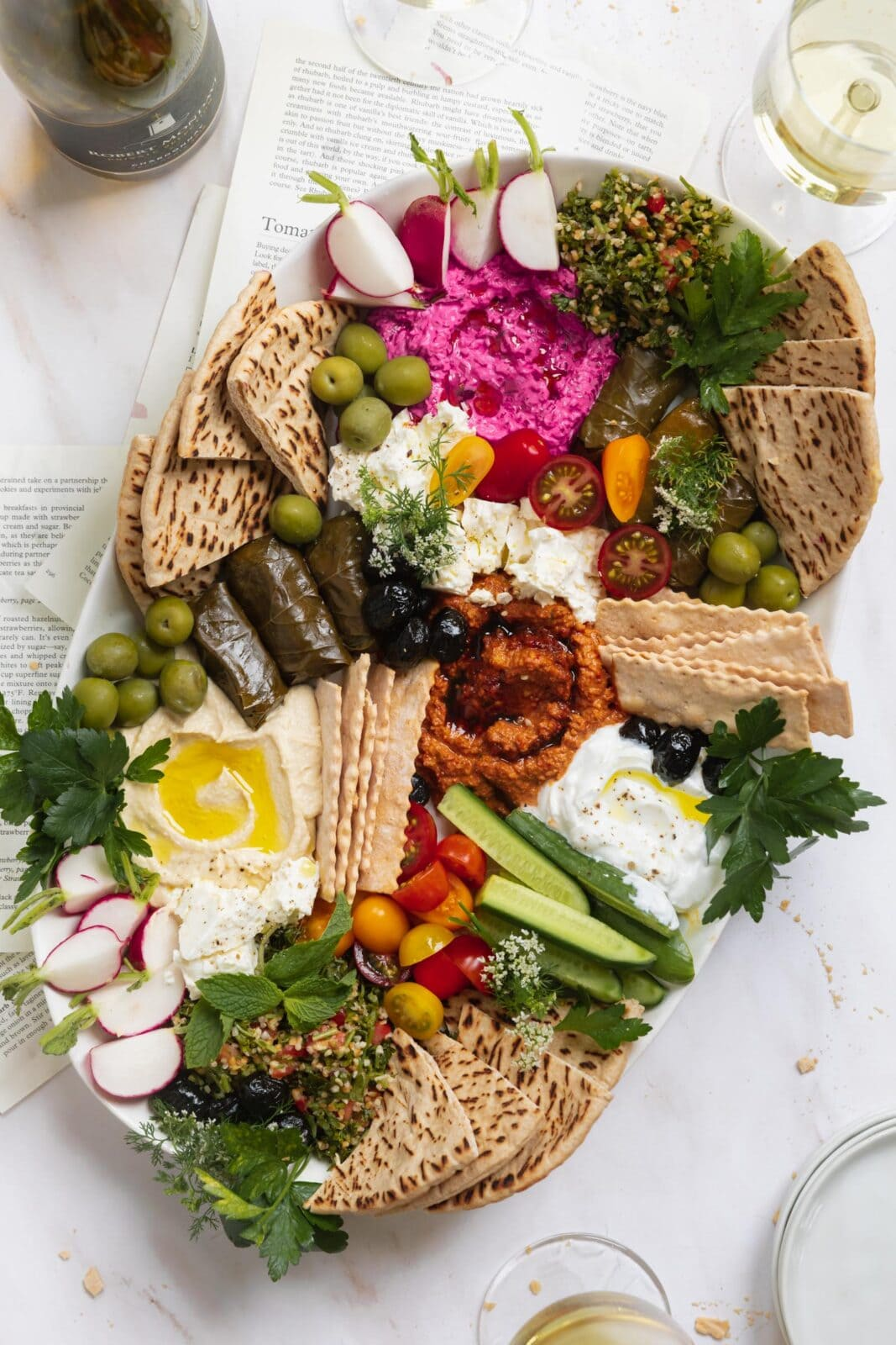 mezze platter with veggies, pita, olives and spreads