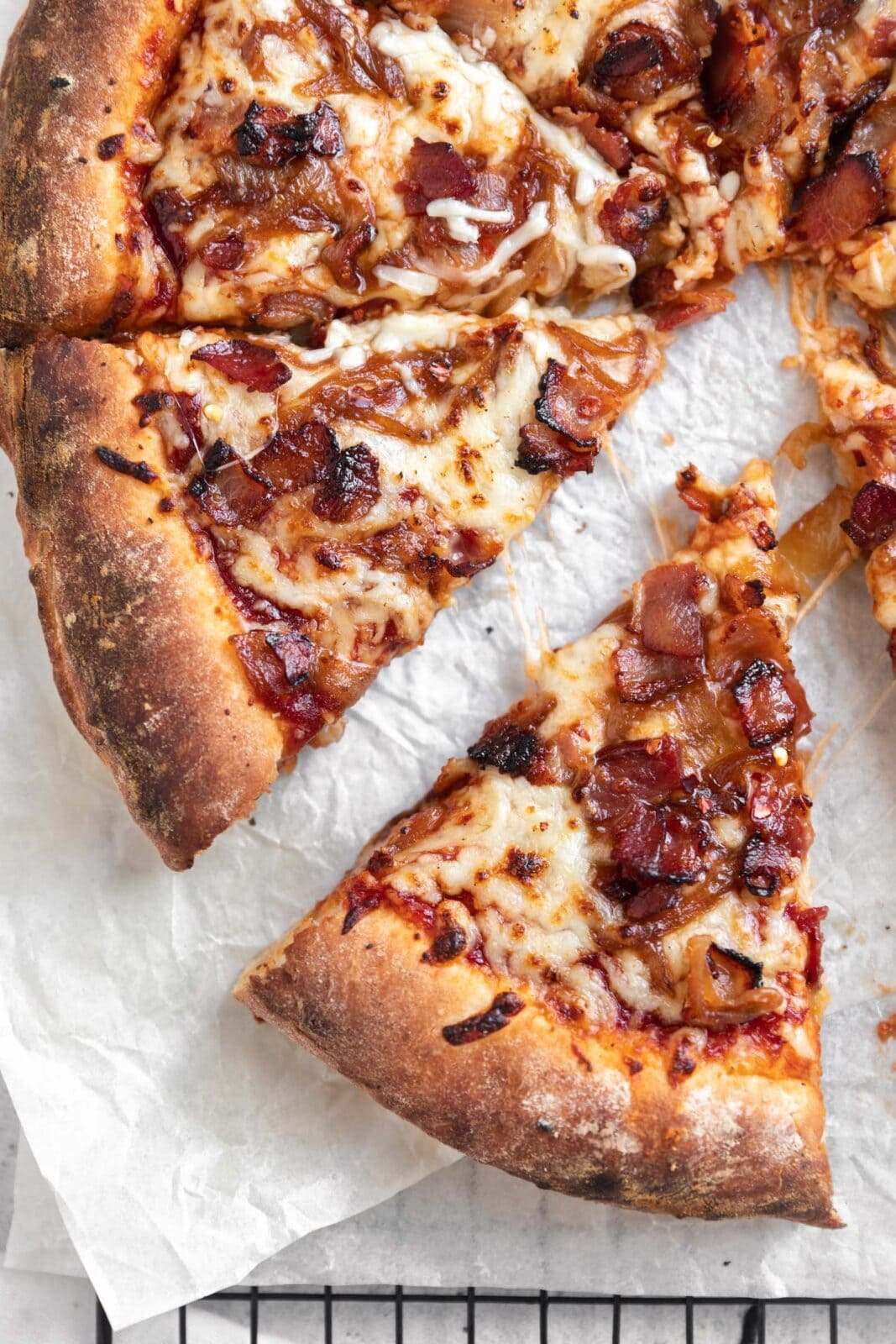 caramelized onion bacon pizza with bbq sauce