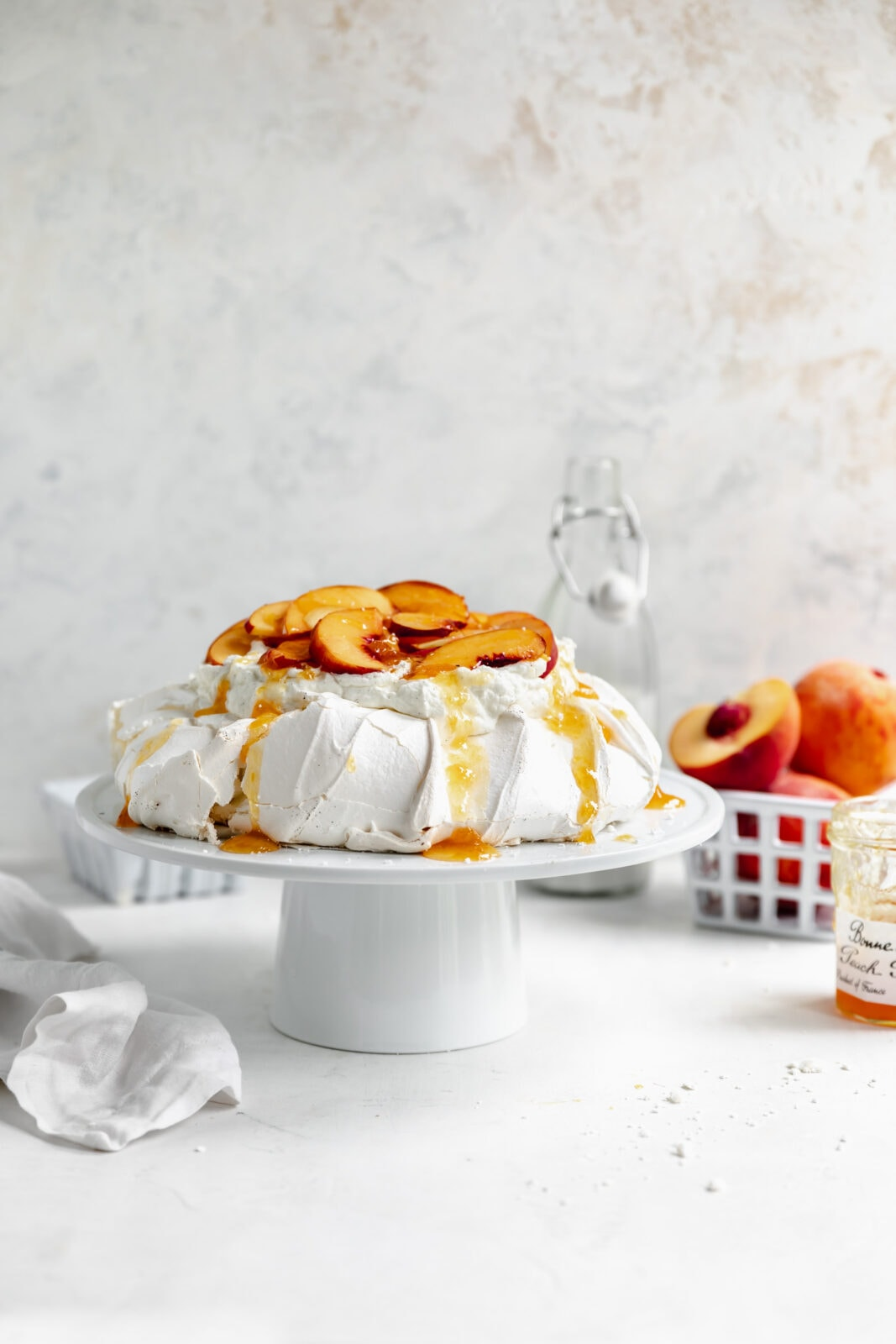 peaches and cream pavlova with fresh peaches