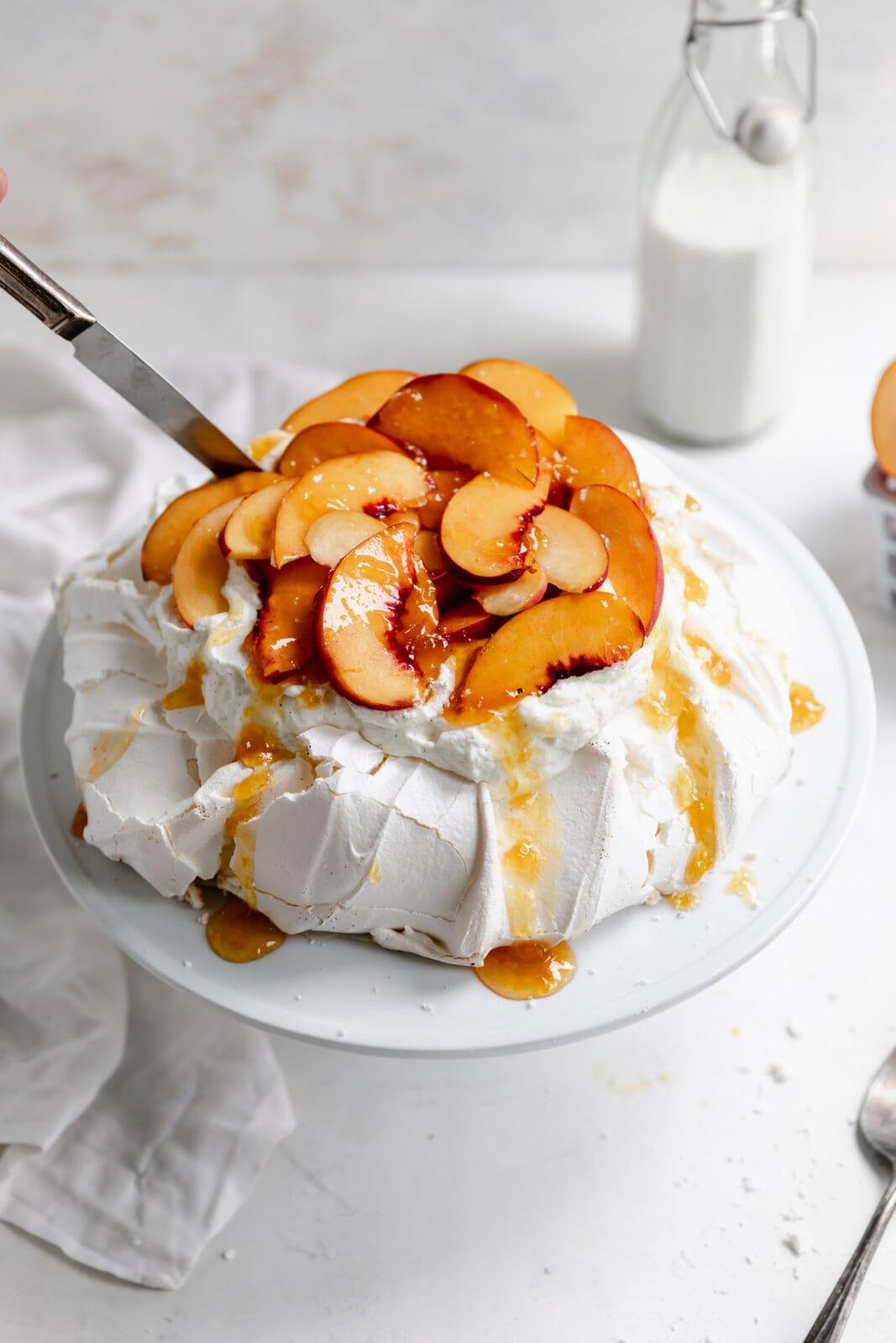 peaches and cream pavlova with peach jam