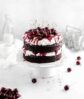 black forest cake with whipped cream with cherries
