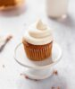 perfect fluffy cream cheese frosting on a carrot cake cupcake