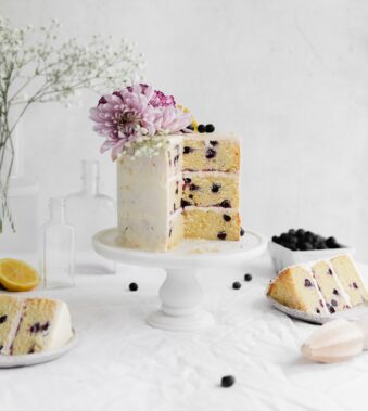 lemon blueberry cake with slices taken out